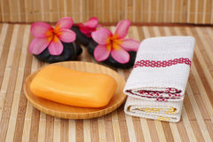 Soap bars with towels. And frangipani flowers Royalty Free Stock Images