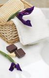 Soap, bath sponge, towel and flower Royalty Free Stock Photos