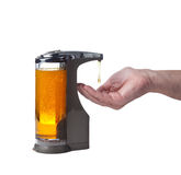Soap being dispensed into hand. Soap or detergent being dispensed into male hand prior to hand washing stock photo