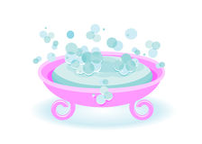 Soap. Blue soap and soap bubbles in a pink soap tray Royalty Free Stock Image