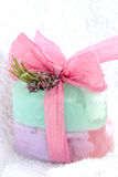 Soap with the bow. Two soaps with the bow and the flower on the white towel Royalty Free Stock Photo