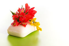 Soap with a bright red and yellow wildflower Stock Image