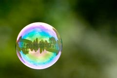 Soap bubble. A soap bubble with a house reflected in it Stock Images