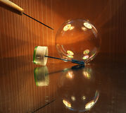 Soap bubble with the awl moment before crash Royalty Free Stock Image