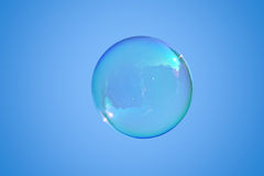 Soap bubble on the blue sky. Real soap-bubble on the blue sky Stock Photo
