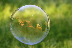 Soap Bubble. This is a soap bubbles with a golden sunset appearing inside the bubble Stock Photo