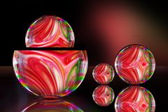 Soap bubble with Colorful liquid paints mixed together creating pattern royalty free stock images