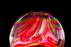 Soap bubble with Colorful liquid paints mixed together creating rainbow pattern stock illustration
