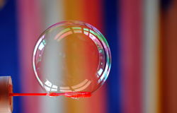 Soap bubble on coloured background. Soap bubble over coloured background Royalty Free Stock Photos