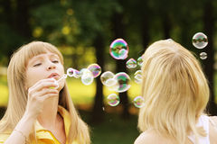 Soap bubble duel Royalty Free Stock Image