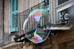 Soap bubble floating in New Orleans French Quarter royalty free stock photography