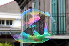Soap bubble floating in New Orleans French Quarter royalty free stock image