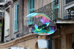 Soap bubble floating in New Orleans French Quarter stock photos