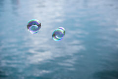 Soap bubble flying over lake water Royalty Free Stock Photography