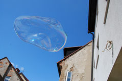 Soap bubble. Giant soap bubble flies to the sky Stock Images