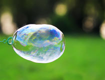soap bubble is inflated and bursts leaving a spray royalty free stock photography