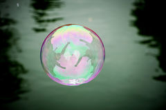 Soap bubble over Ljubljanica. Stock Photos