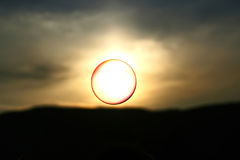 Soap bubble in the sky. Soap bubble flying at sunset Stock Photography