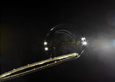 SOAP bubble on a stick on a dark background Stock Images