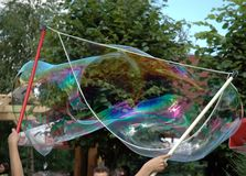 Soap bubbles. Happy children plays Stock Photos