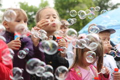 Soap bubbles. Festival Bubbles, organized by the Foundation for Children with blood cancer Fund Alena Petrova in city garden, July 25, 2009 in Tomsk, Russia Royalty Free Stock Photo
