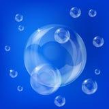 Soap bubbles. Group pf transoarent soap bubbles on the blue background stock illustration