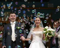 Soap bubbles. Happy newly-married couple on a background of soap bubbles Royalty Free Stock Images