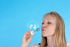 Soap bubbles. Pretty blond girl with the soap bubbles Stock Photography