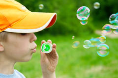 Soap bubbles. Boy blowing soap bubbles.Close-up Royalty Free Stock Photography
