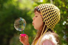 Soap bubbles. A little girl blowing soap bubbles Stock Photos