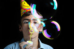 Soap bubbles. Young boy blowing soap bubbles, children's birthday party Stock Photography