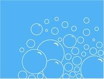 Soap bubbles. White soap bubbles on blue background Stock Photos