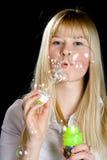 Soap bubbles. The girl inflates soap bubbles Stock Photos