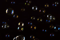 Soap Bubbles. Abstract background. Multicoloured soap bubbles on a black background Royalty Free Stock Images