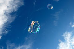 Soap bubbles. Against Blue Sky Background royalty free stock photos