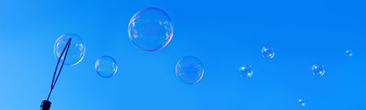 Soap bubbles against blue sky. Stock Images
