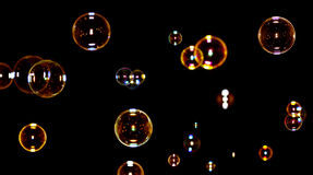 Soap bubbles on black Stock Photo