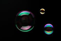 Soap Bubbles On A Black Background Stock Photos