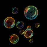 Soap bubbles on black background Stock Images