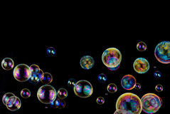 Soap bubbles on black background Stock Photography