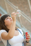 Soap bubbles blowing Stock Photo