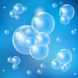 Soap bubbles on a blue background Royalty Free Stock Photos