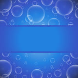 Soap bubbles on a blue background with frame Stock Photos
