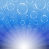 Soap bubbles on a blue background with lights Royalty Free Stock Images