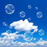 Soap bubbles on blue sky Royalty Free Stock Photo