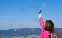 Soap bubbles on blue sky Royalty Free Stock Photography