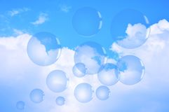 Soap bubbles on blue sky Stock Image