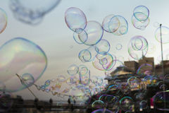 Soap bubbles, building in background Royalty Free Stock Images