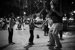 Soap bubbles. Children having fun with soap bubbles on Plaça de Catalunya in Barcelona Royalty Free Stock Photos