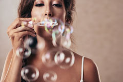 Soap bubbles. Close-up image of girl blowing bubbles, selective focus Royalty Free Stock Photo